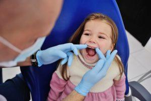 Examining baby teeth