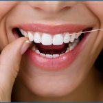 Why should you floss your teeth before brushing?